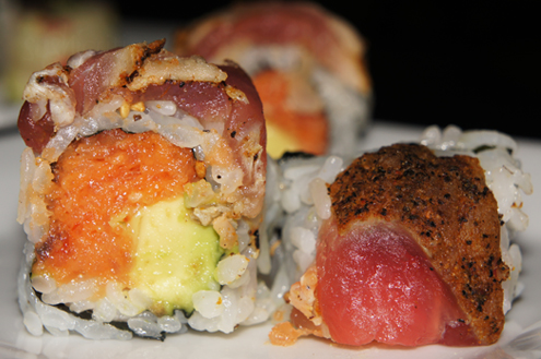 and avocado inside, with Cajun seared peppered tuna on top. The roll ...